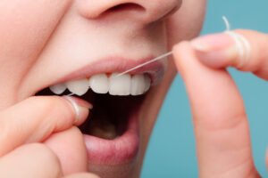 You Know You Should Brush for Two Minutes – But How Long Should You Floss For?